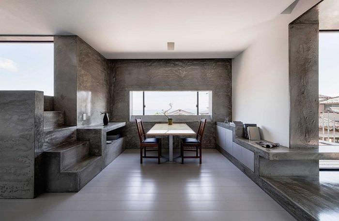 Двухцветный интерьер обеденной зоны на кухне в стиле минимализма