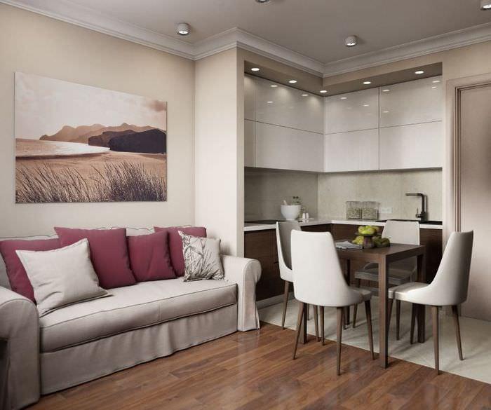 Серый диван и обеденный столик в кухне-гостиной