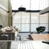 Серый интерьер квартиры-студии в стиле лофт