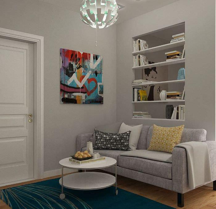 Интерьер гостиной в серых тонах в однокомнатной квартире 38 кв м