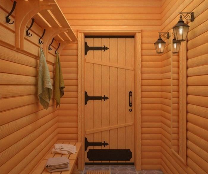 Вешалка для одежды в комнате отдыха в бане