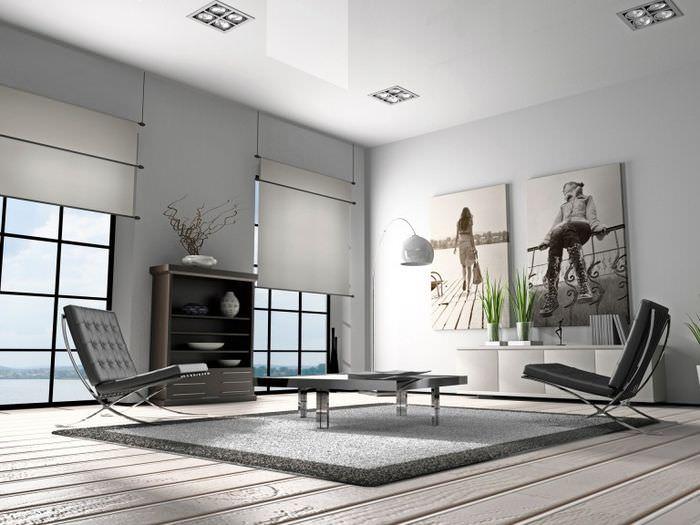 Белая гостиная частного дома в стиле минимализма