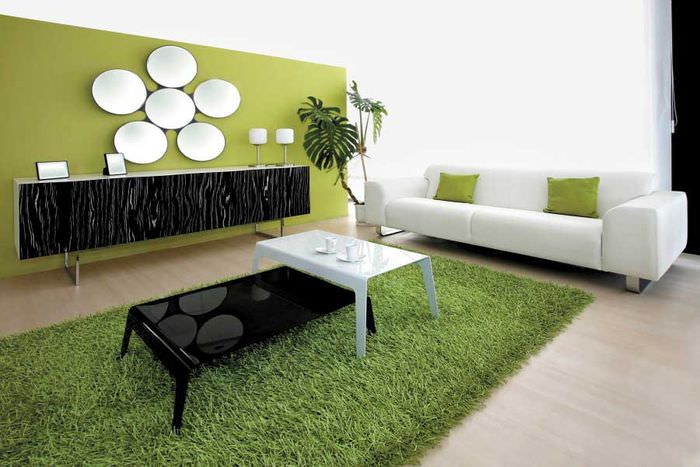 Зеленый ковер в интерьере гостиной в стиле минимализма