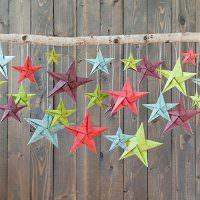Палка с бумажными звездами разного цвета