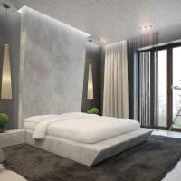 Белая кровать в спальне стиля минимализма