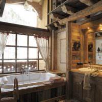Акриловая ванна перед окном в загородном доме