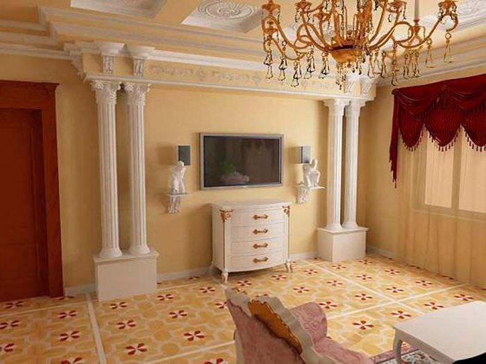 Современный телевизор на стене между античными колоннами