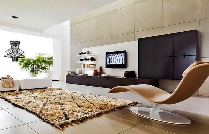 Современное кресло с плавными формами в гостиной стиля хай-тек