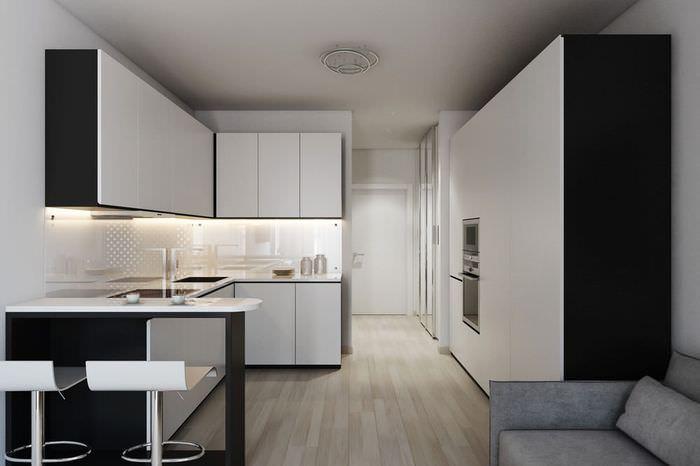 Кухонная зона в квартире-студии стиля минимализм