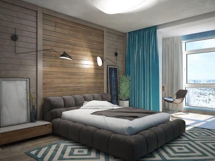 Интерьер спальни с отделкой стен имитацией бруса