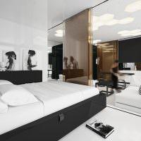 Черная кровать с белым матрасом