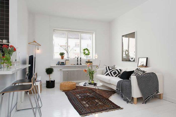 Декорирование текстилем светлой скандинавской гостиной
