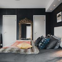 Современная спальня с черными стенами