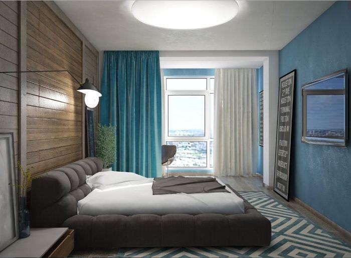 Спальня с бирюзовыми стенами в трешке кирпичного дома серии П44-Т
