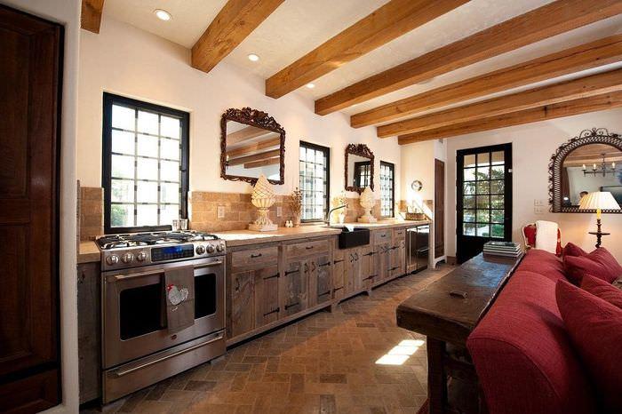 Интерьер кухни частного дома без навесных шкафов