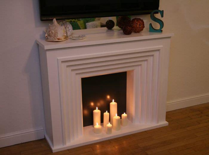 Декоративный камин с парафиновыми свечами своими руками