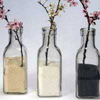 Цветущие веточки в бутылках с крупами