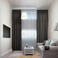 Черный телевизор на светло-серой стене
