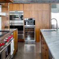 Дизайн кухни с отделкой мебели под дерево