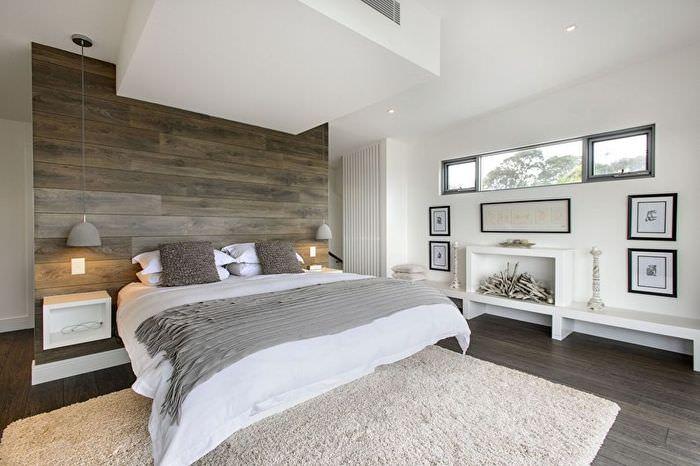 Декорирование стены спальни натуральным деревом