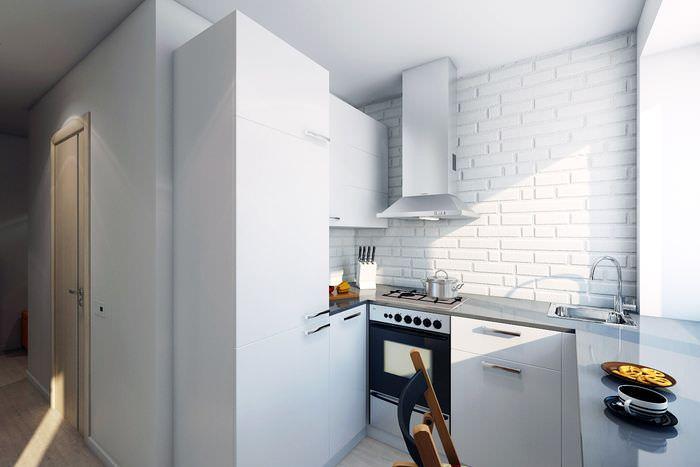 Небольшая кухня с белой кирпичной стеной