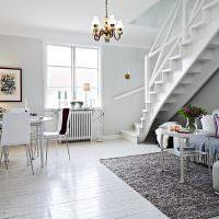 Гостиная с лестницей в скандинавском стиле
