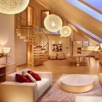 Винтовая лестница в мансардном помещении