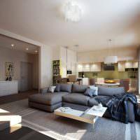 Угловой диван серого цвета в квартире-студии