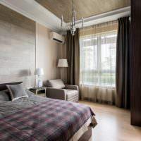 Белый кондиционер на стене спальни