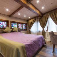 Сочетание фиолетового и коричневого цветов в интерьере спальни