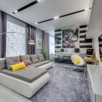 Дизайн вытянутой гостиной в серых тонах