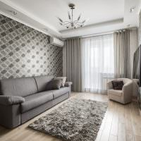 Оформление интерьера гостиной в серых тонах