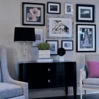 Коллекция картин над черным комодом