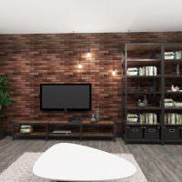 Телевизионная панель на кирпичной стене