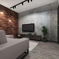 Черный телевизор в гостиной с кирпичной стеной