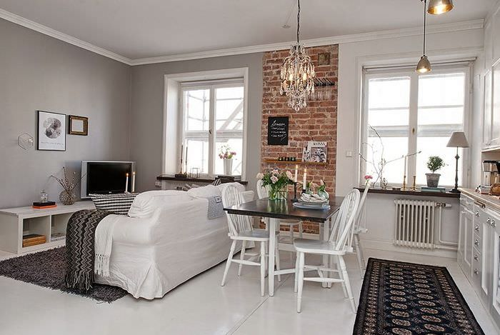 Кирпич в интерьер кухни-гостиной скандинавского стиля