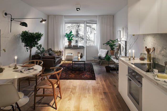 Кухня-гостиная в скандинавском стиле с балконом