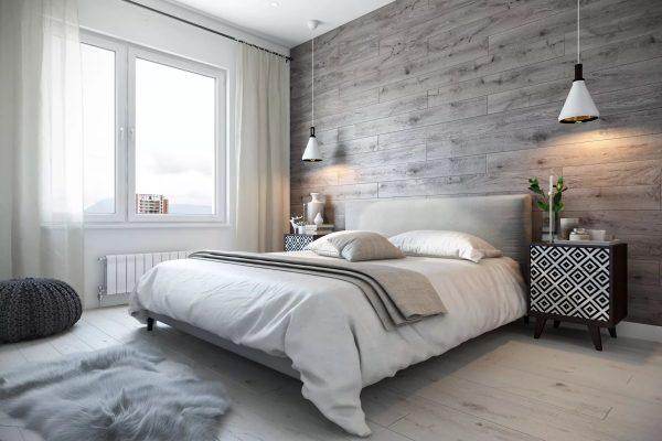Уютная спальня, выполненная в светлых тонах с незначительными темными акцентами