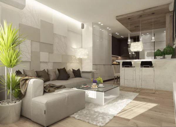 Специалисты рекомендуют не бояться соединять гостиную с кухней, так как порой это единственный вариант для расширения зоны.